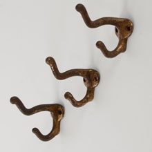"Hefty Set of 3 Cast Iron ""Elephant Trunk"" Coat Hooks, c1910"