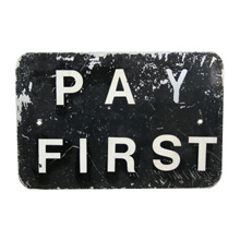Well-Worn Black and White Pay First Sign C1960