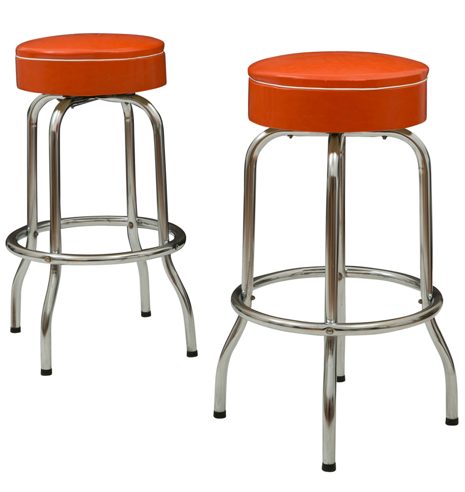 pair of midcentury bar stools w orange vinyl