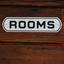 """ROOMS"" Stamped Steel Sign, c1950"