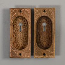 Pair of Aesthetic Movement Bronze Pocket Door Pulls, c1882