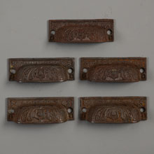 Set of 5 Cast Iron Decorative Bin Pulls, c1885