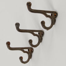 Set of 3 Decorative Cast Iron Double Coat Hooks, c1890